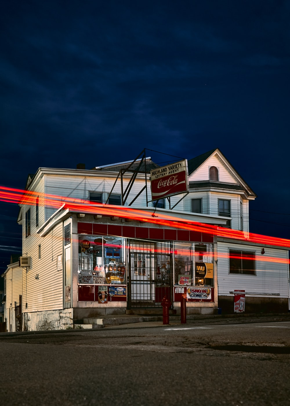 time lapse photo of storefront during nighttime