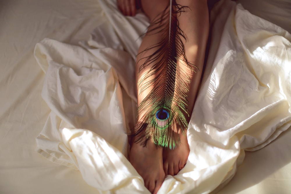 green peacock eye tattoo