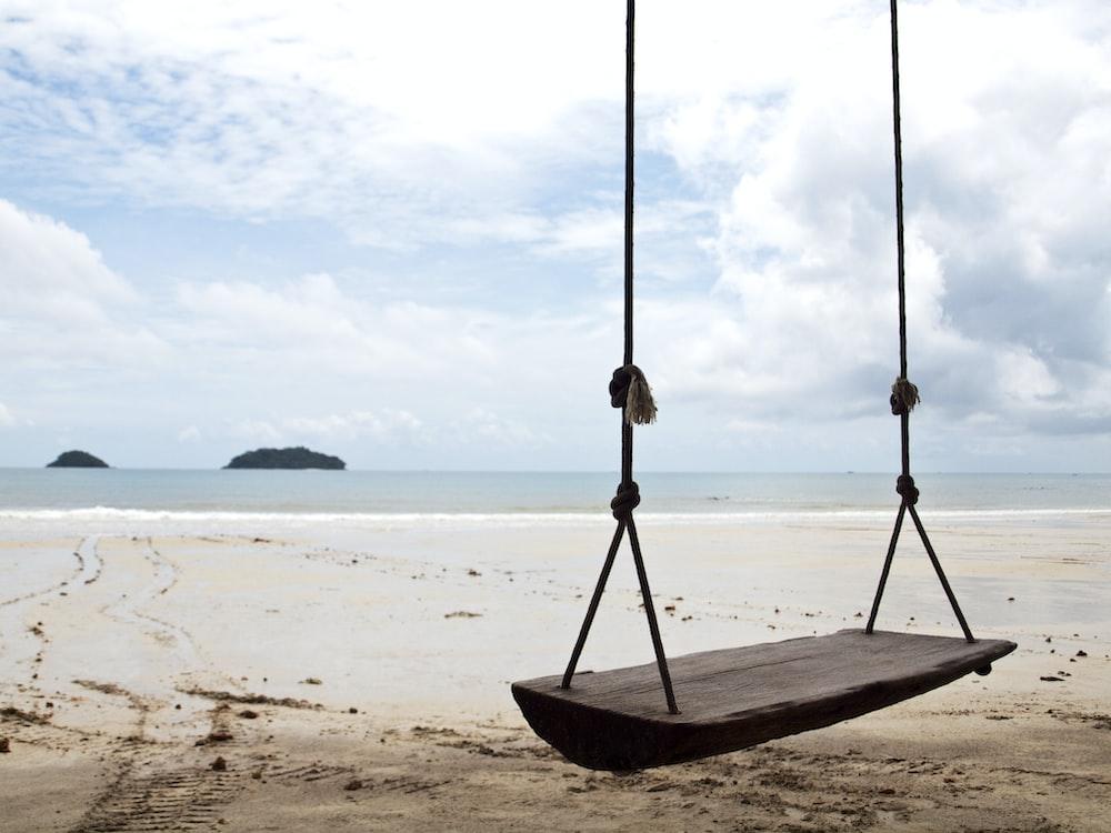 brown wooden rope swing