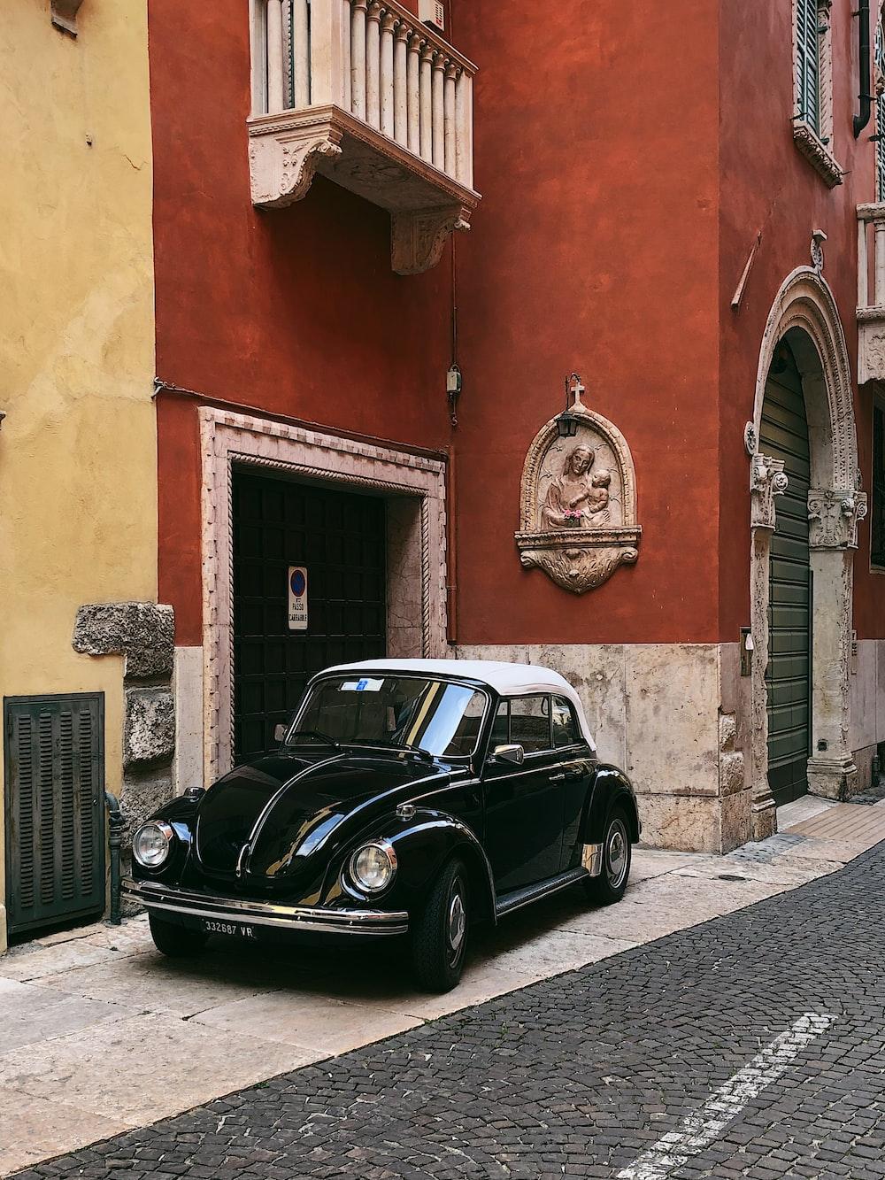 black Volkswagen Beetle near building