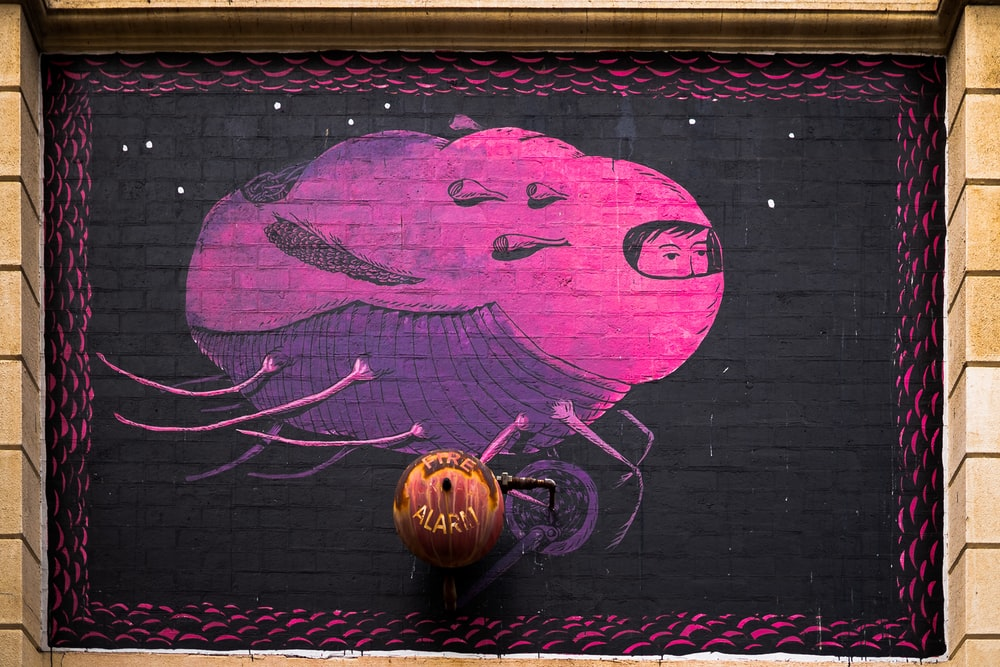 purple and black painting on wall