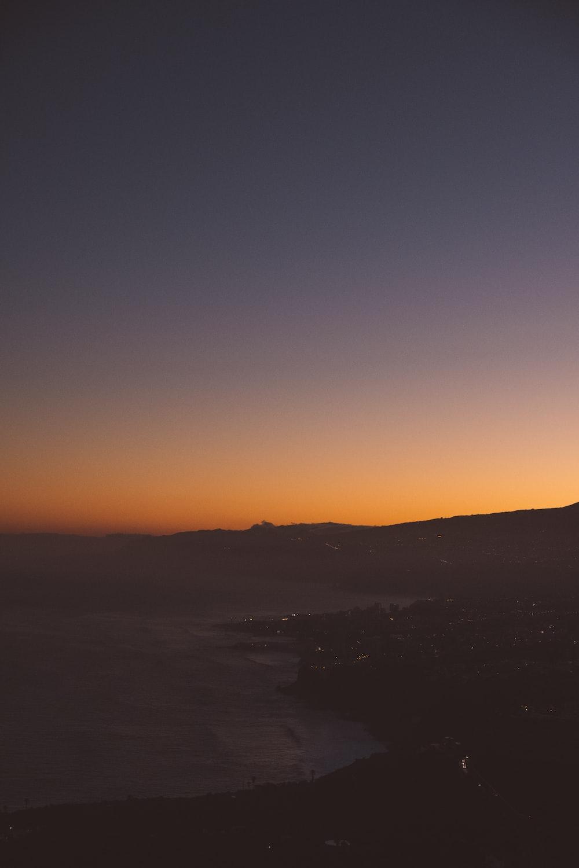 orange sky over beach at dusk
