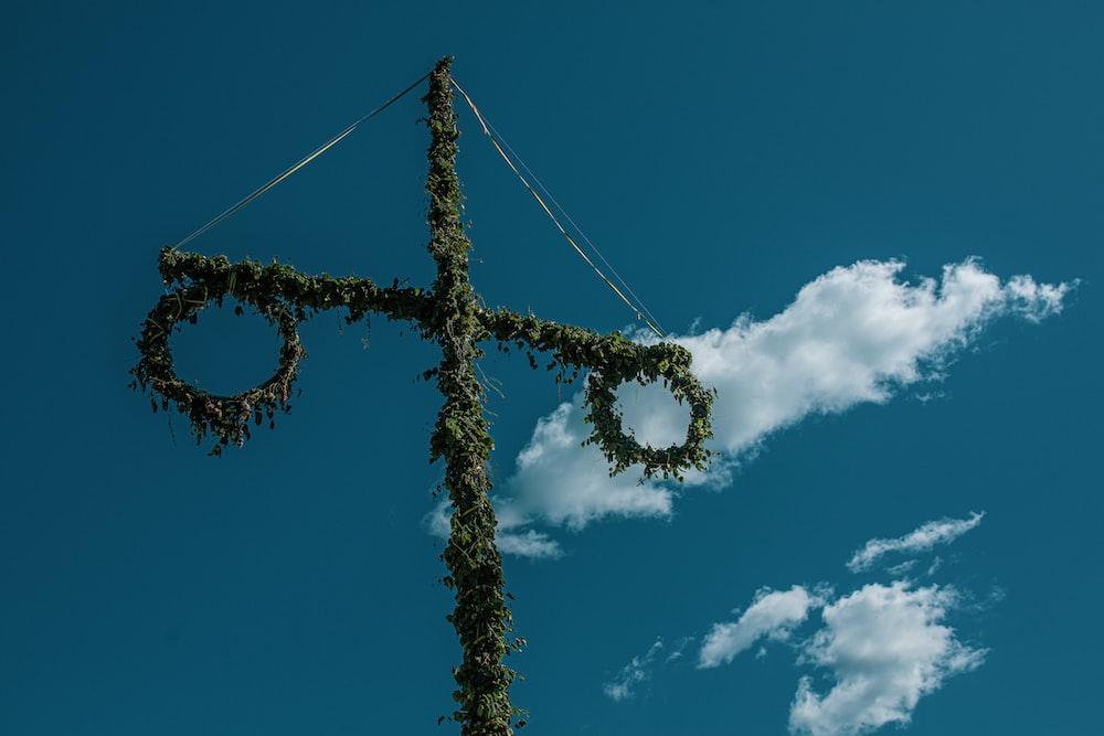 green cross under blue sky