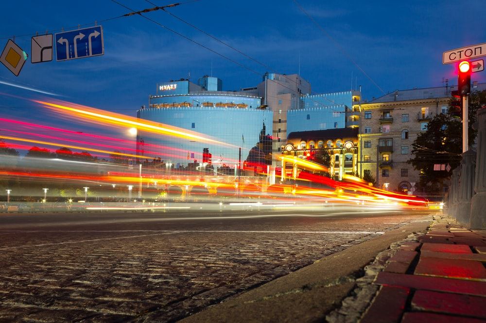 time-lapse photography of car passing near building