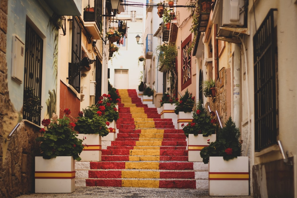red, yellow, and white concrete stairs