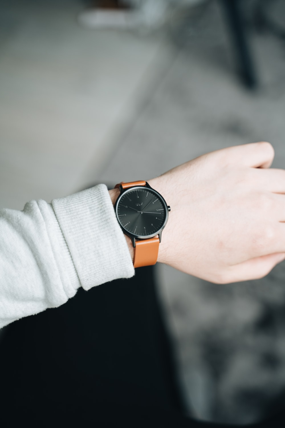 person wearing analog watch