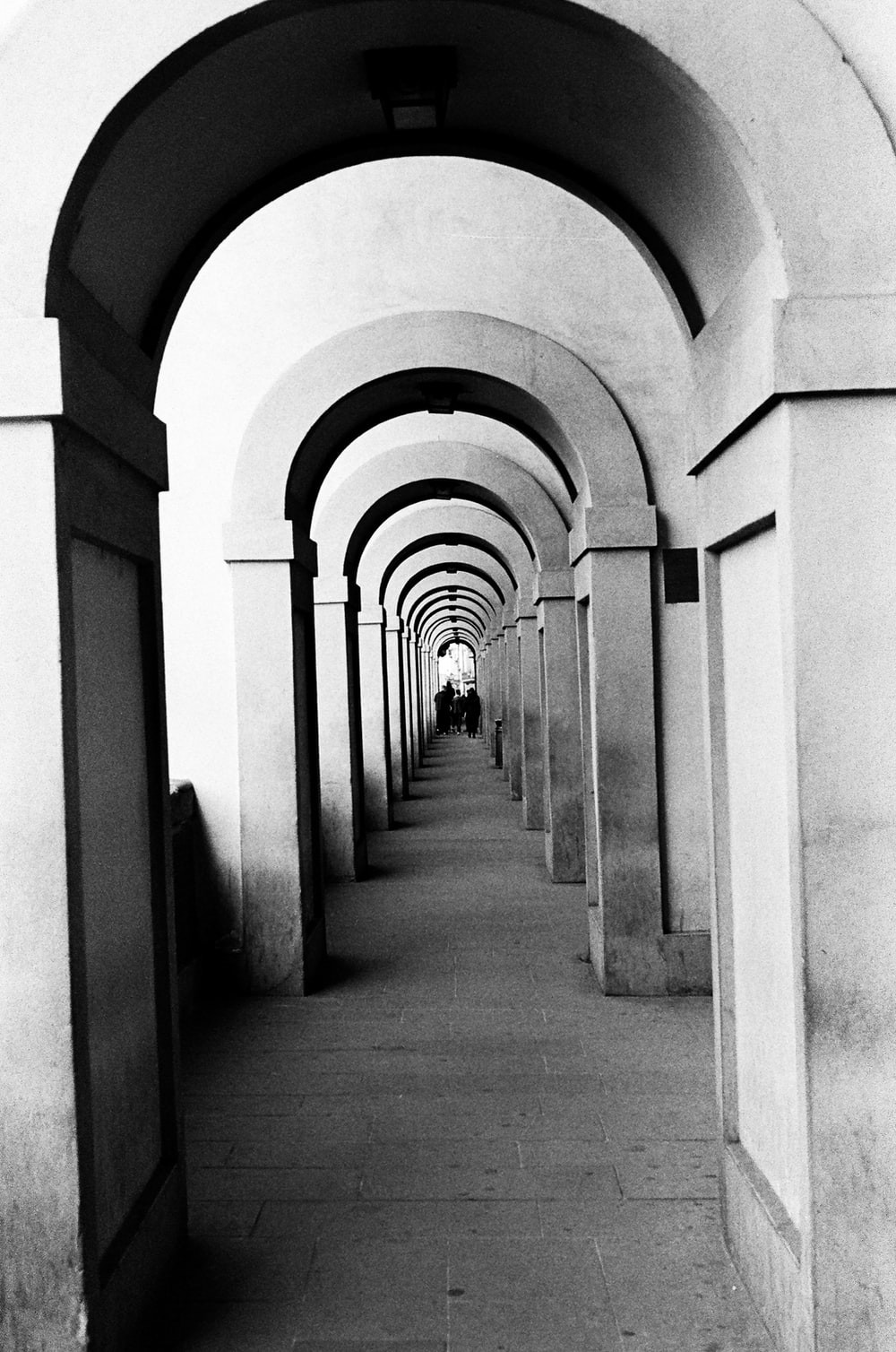 grayscale photography of hallway