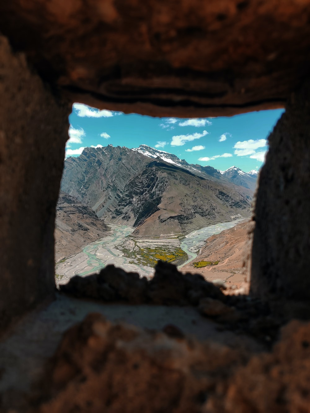 mountains and body of water through ssquare hole