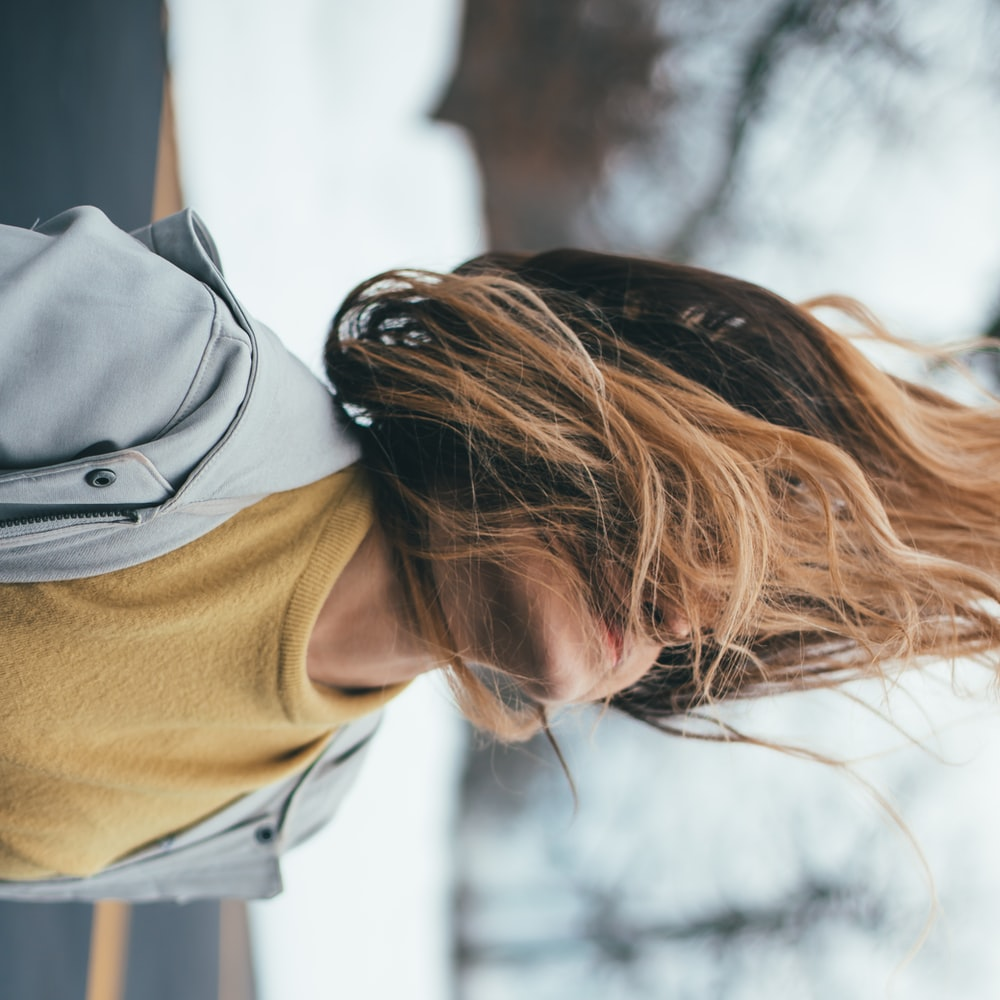woman in gray jacket on selective focus photography