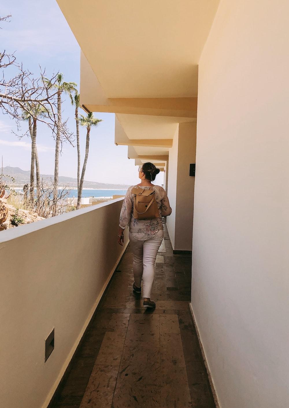 woman walking near walkway inside building