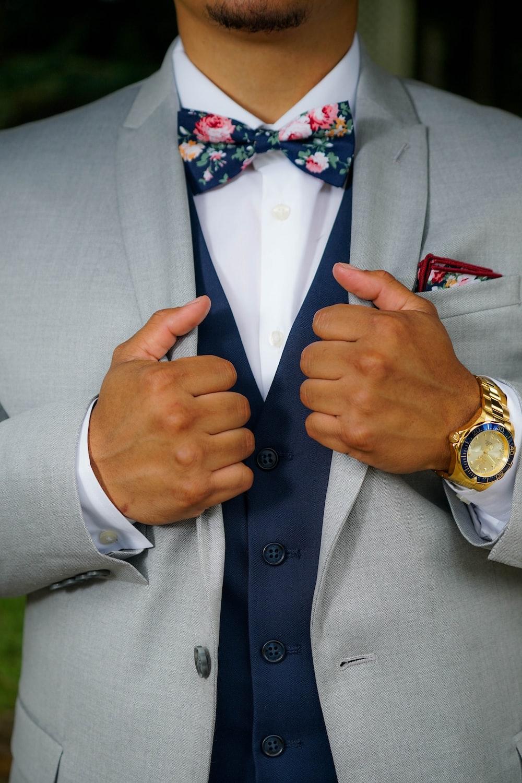 person wearing gray blazer