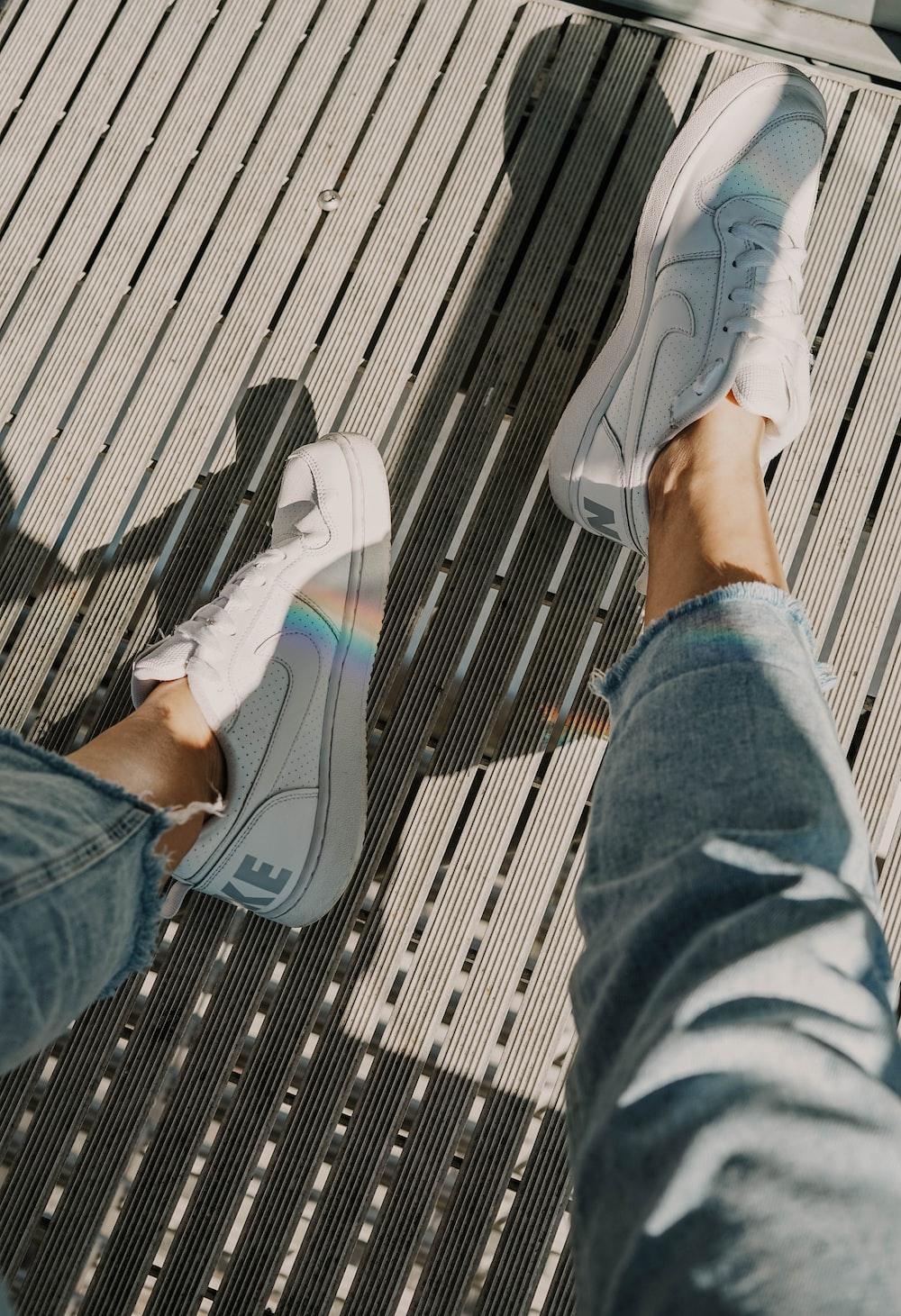 pair of white Nike sneakers