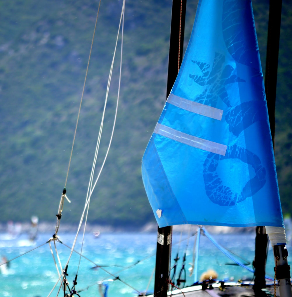 close-up photography of blue sailboat during daytime