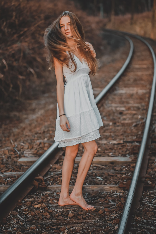 woman standing on railway