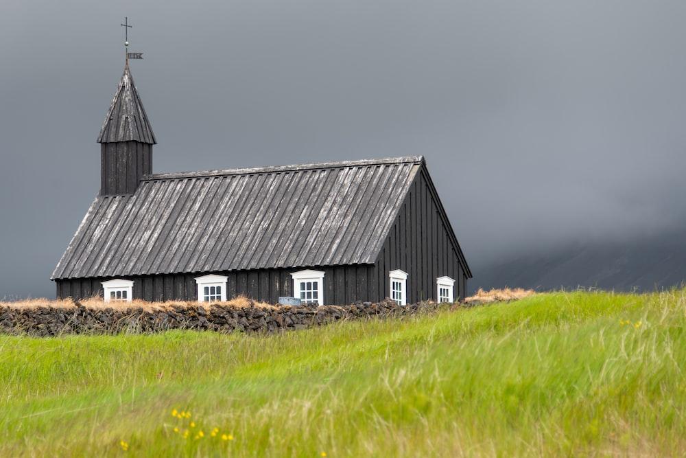 grey church on green field