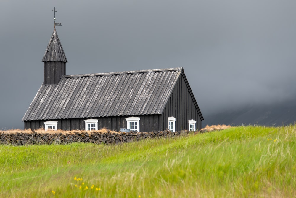 grey church on green field