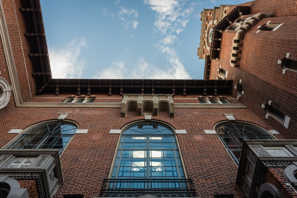 worm's eye view photo of brown brick building