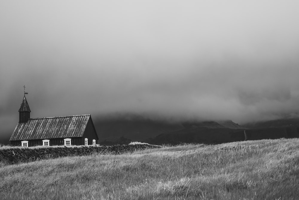 barn at the field during cloudy day