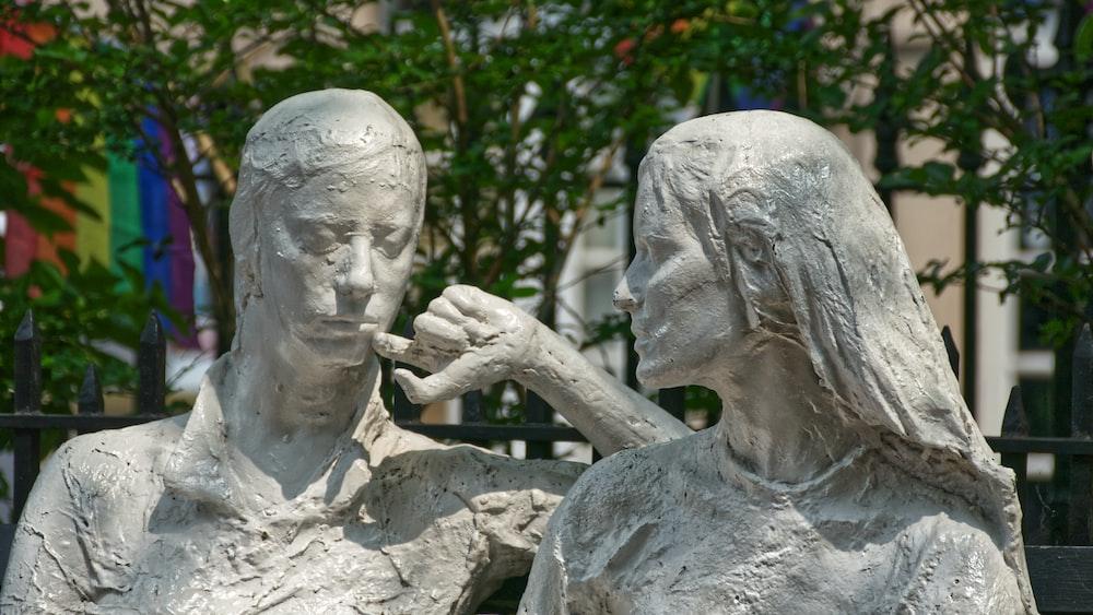 concrete man and woman statue