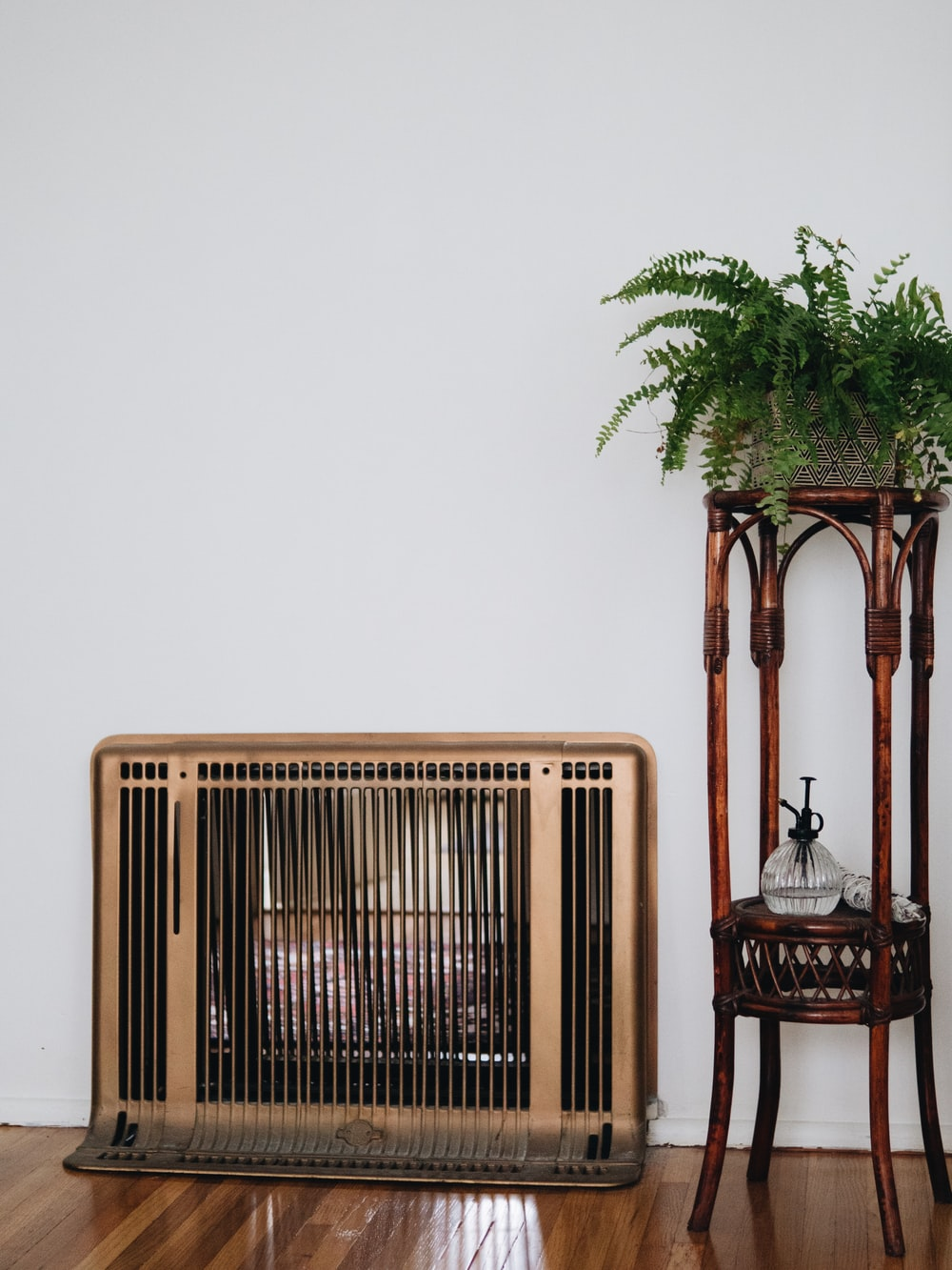 white electric heater besides green plants