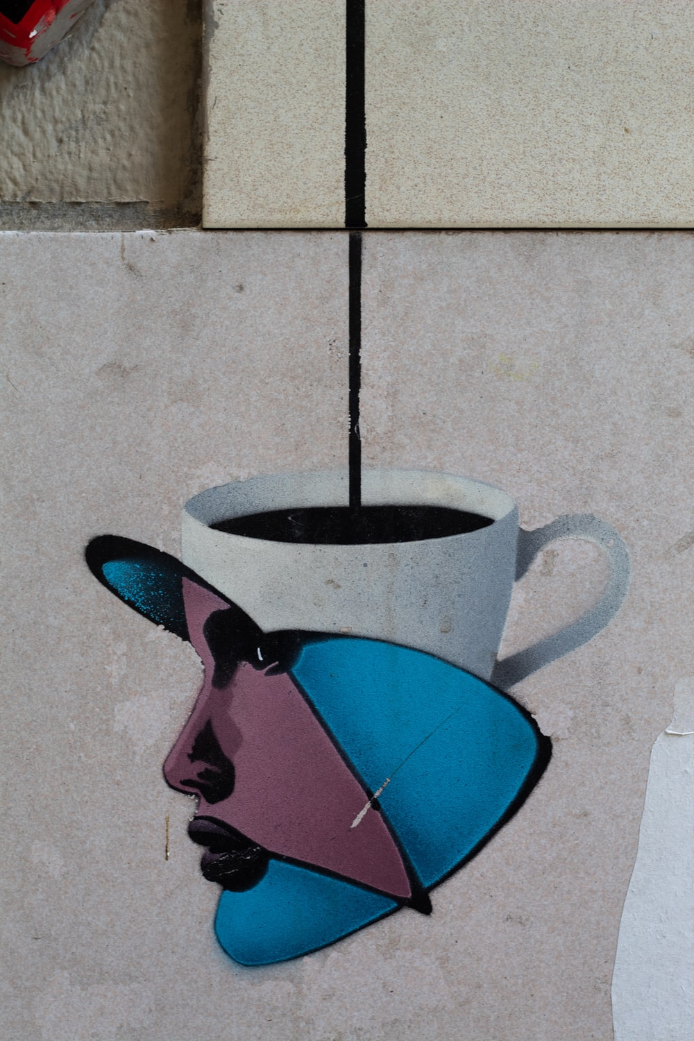 white, blue, and maroon woman's face themed mug
