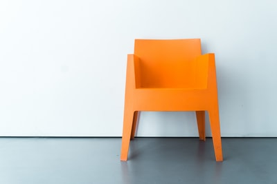 orange plastic armchair chair zoom background