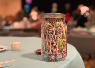 candies in a jar close-up photography