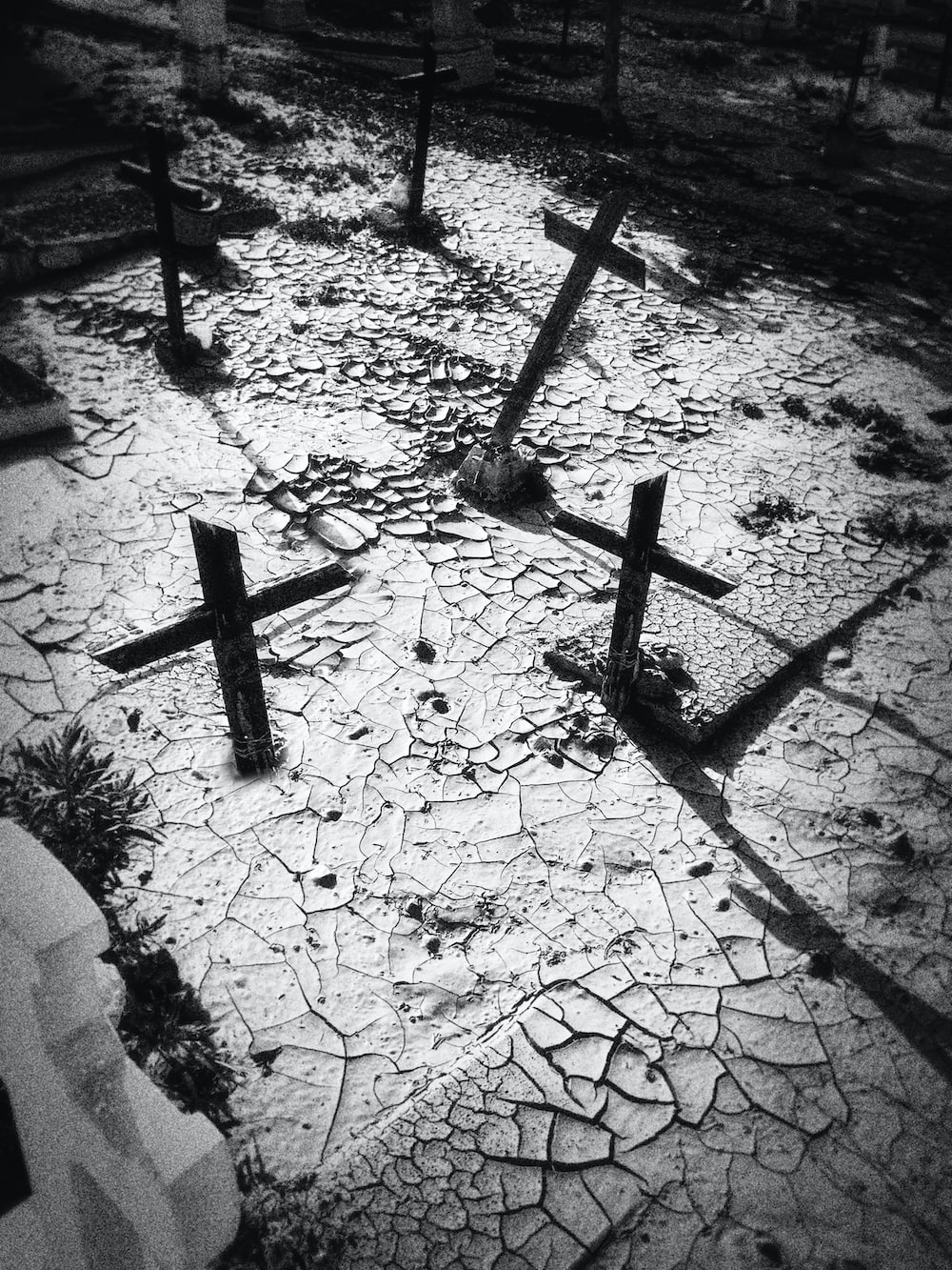 gray scale photo of cross on soil