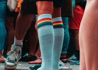 person wearing teal and multicolored knee-high socks