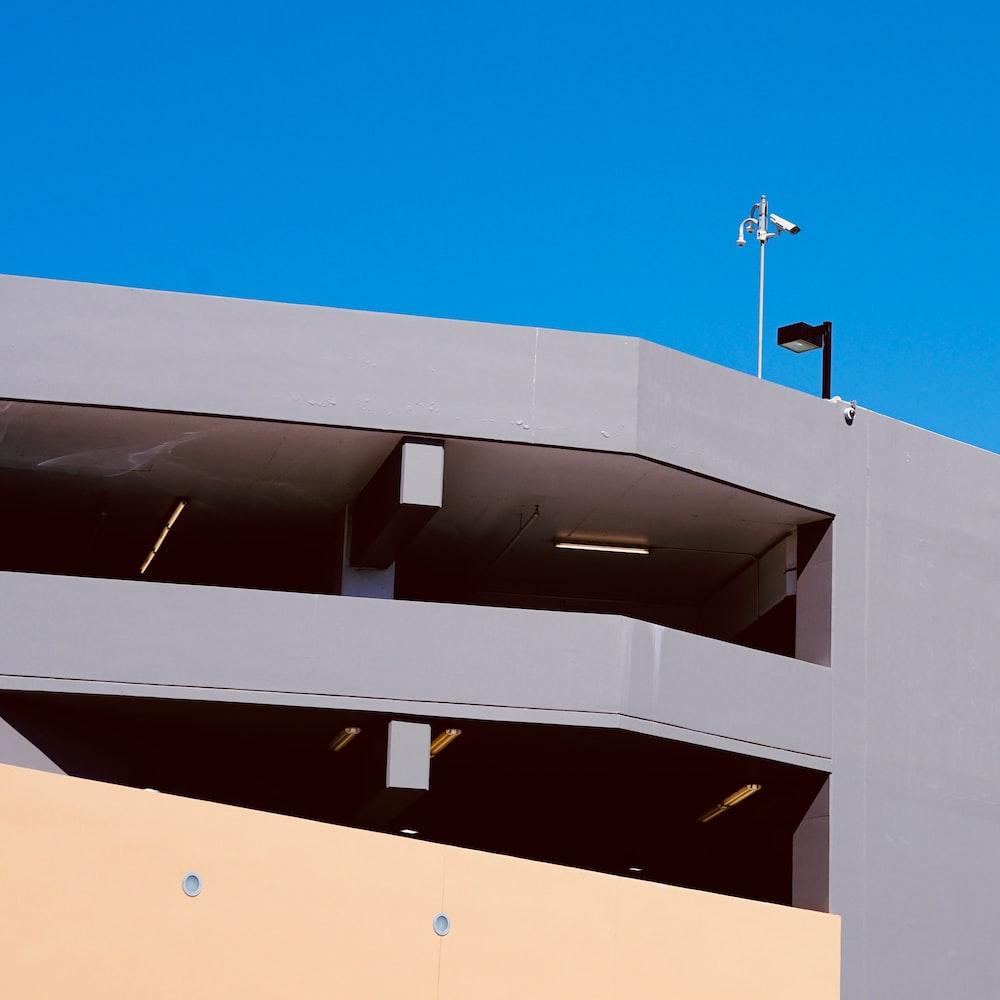 grey concrete building under blue sky