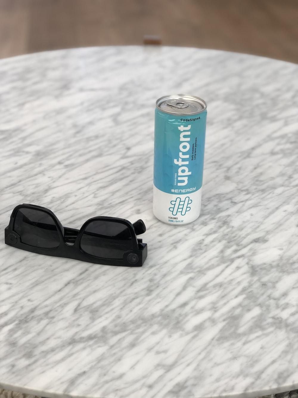 Upfront can beside black framed eyeglasses