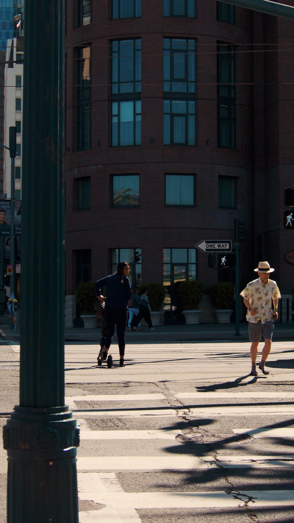 man walking near road during daytime