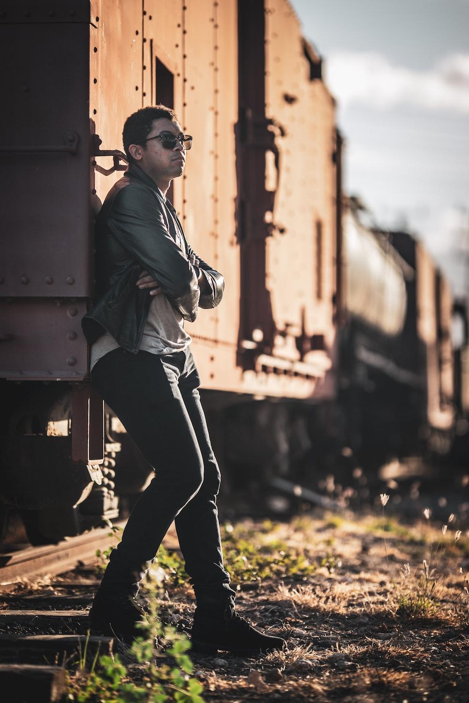 man standing beside train