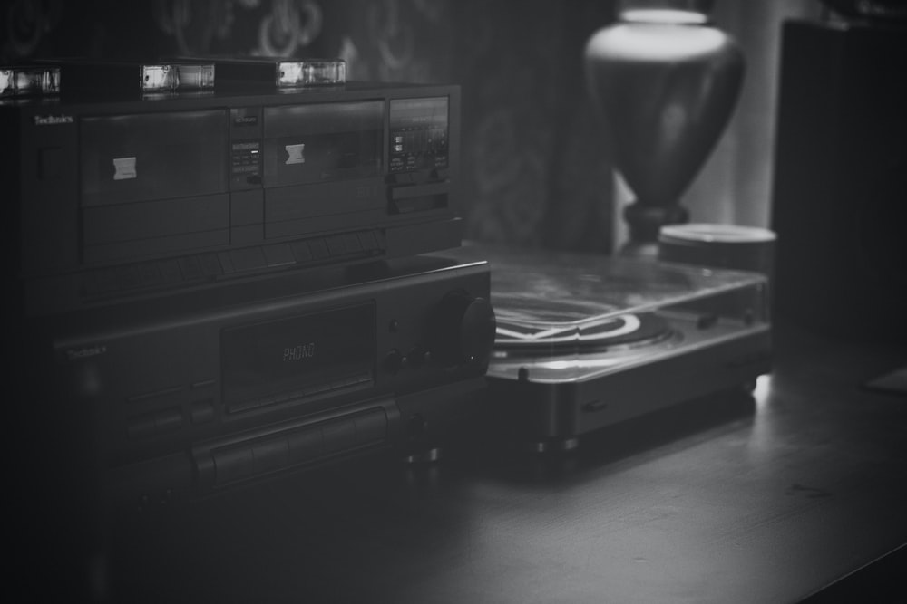 grayscale photo of audio and cassette players