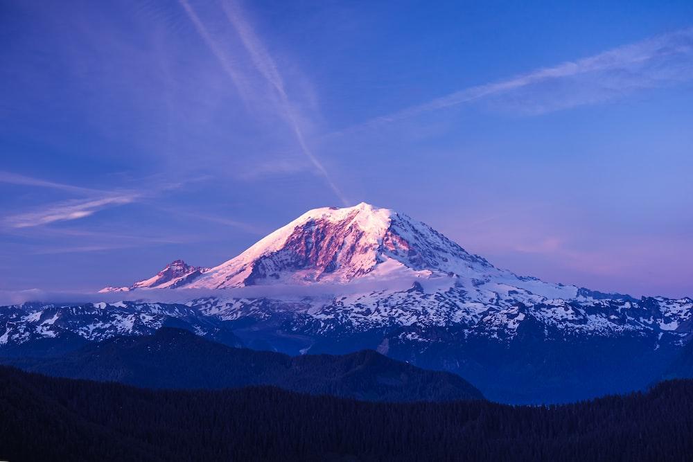 selective focus photography of glacier mountain under blue sky