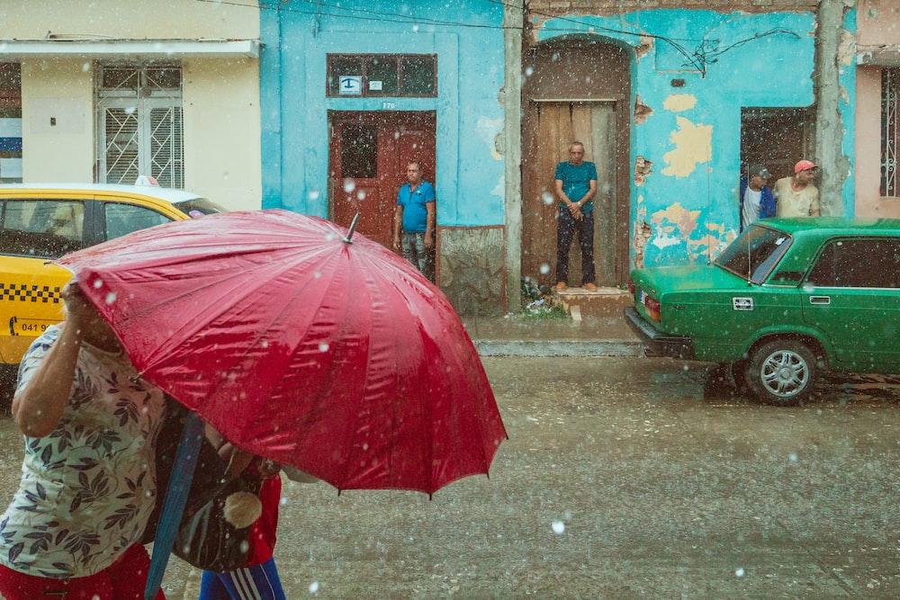 woman using umbrella