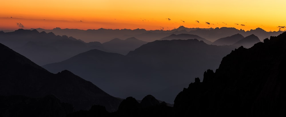silhouette view of mountains during golden hour