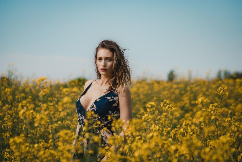 woman standing on flower field
