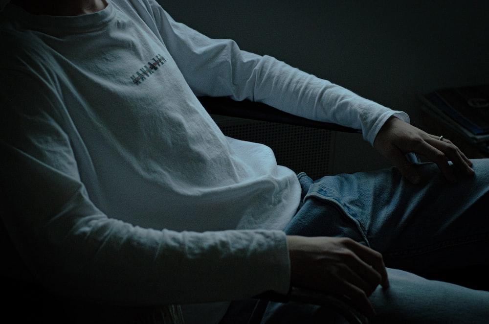 man wearing white long-sleeved shirt