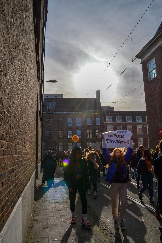 people marching between buildings
