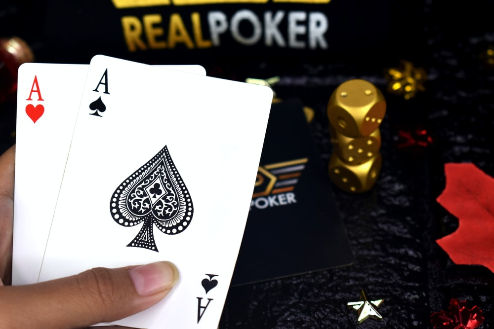 two ace of spade and ace of heart playing cards