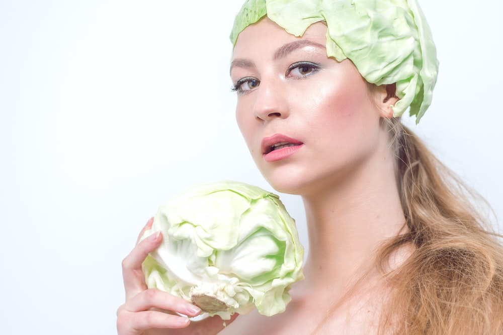 woman with hea dof cabbage