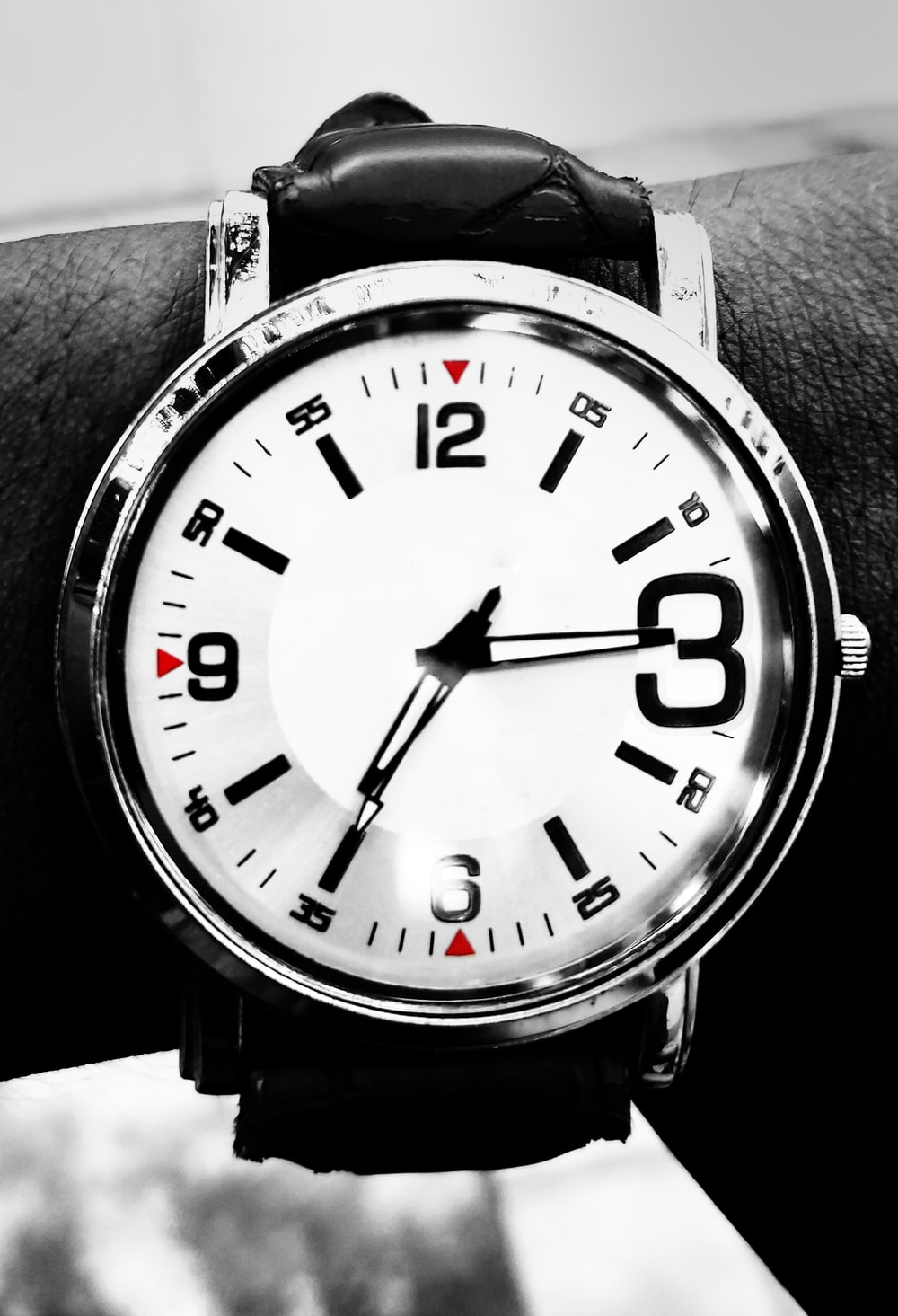 black and white analog watch with black straps