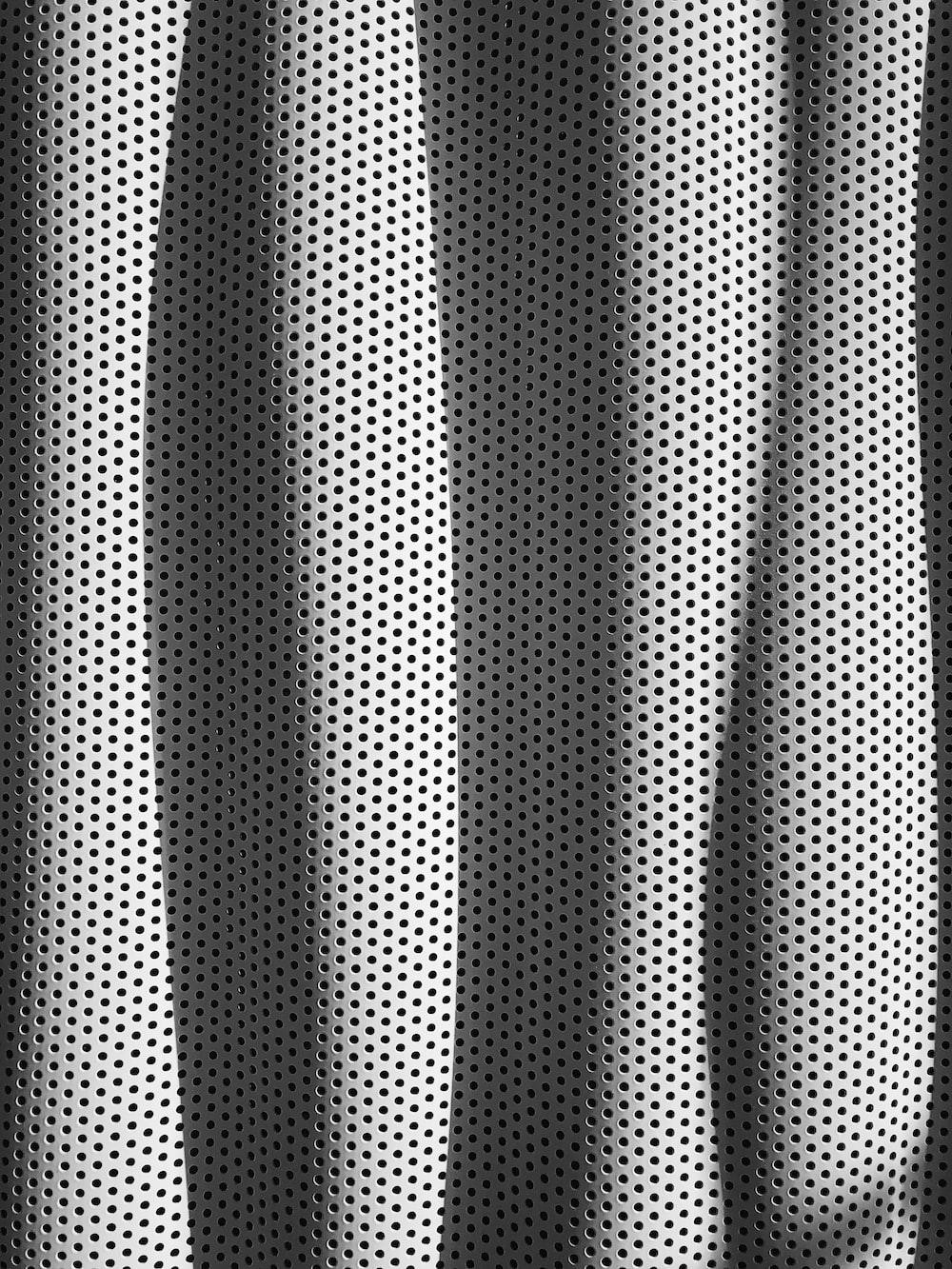 white and black polka-dot fabric