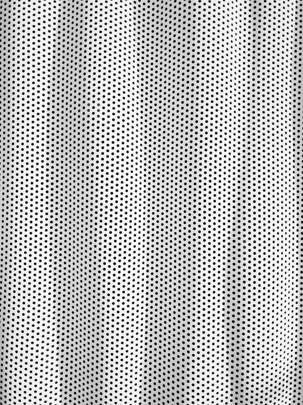 white and black polka dot textile