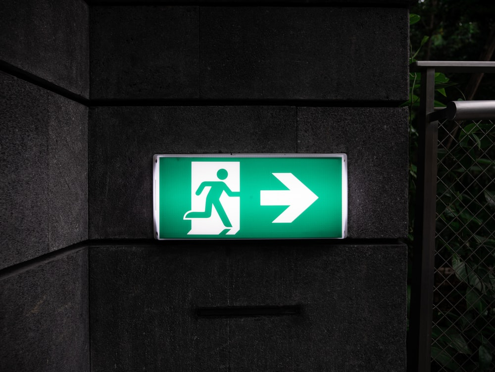 white and green Exit sign