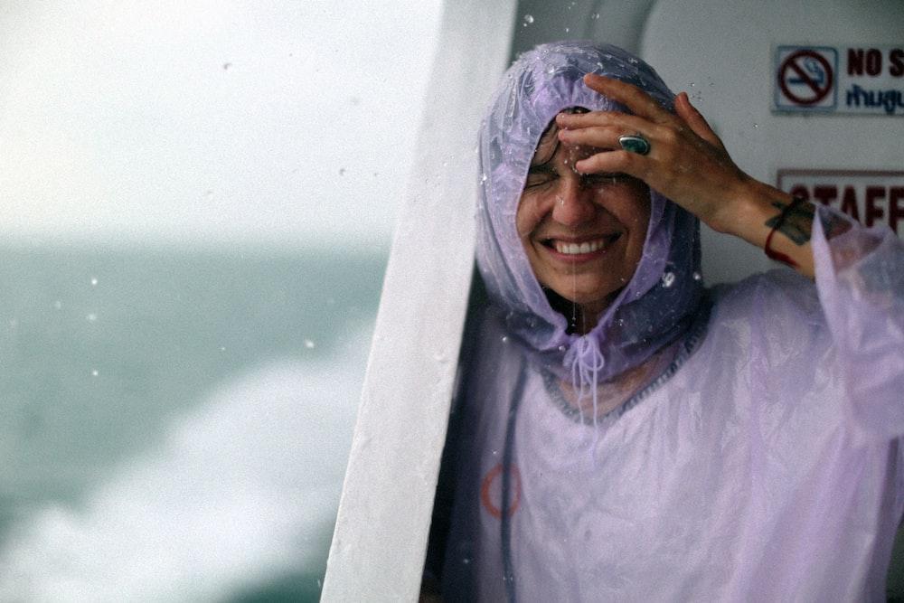 woman wears purple raincoat got wet