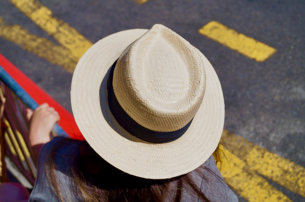 woman wearing beige hat