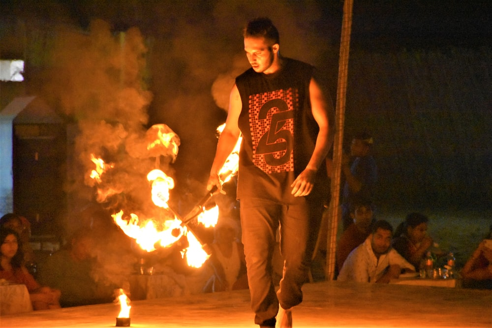 male fire dancer performs on stage