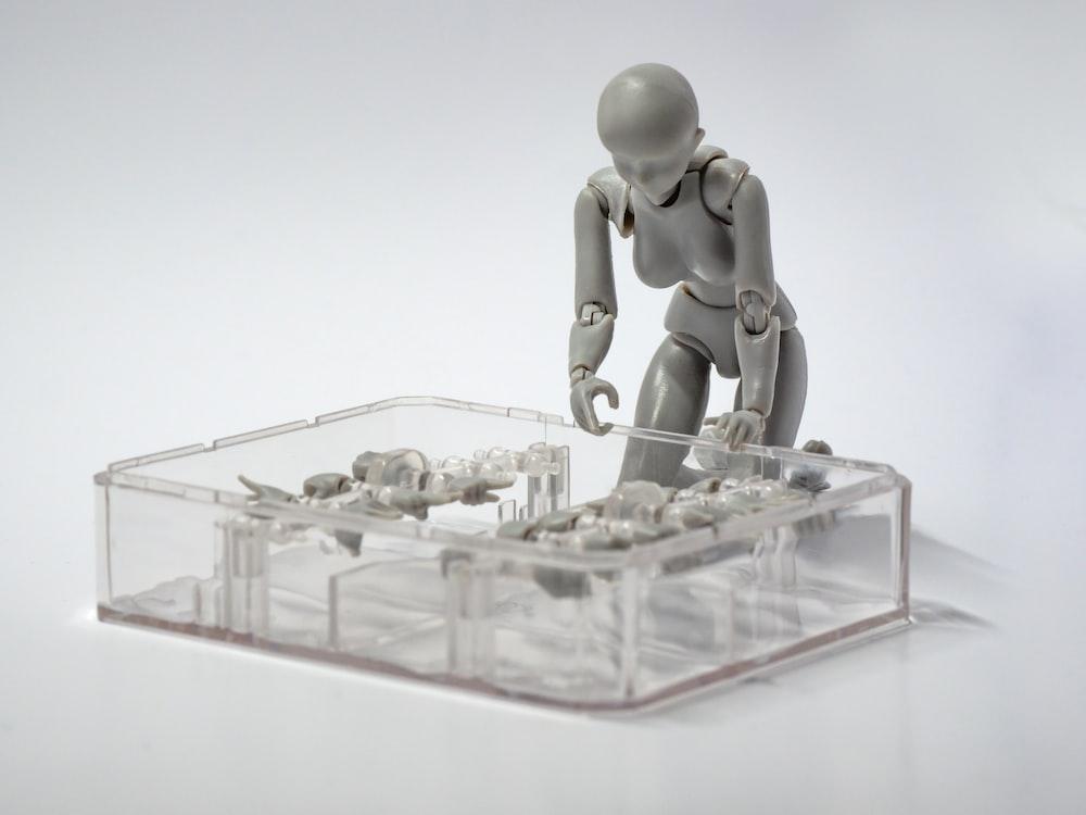 gray plastic doll